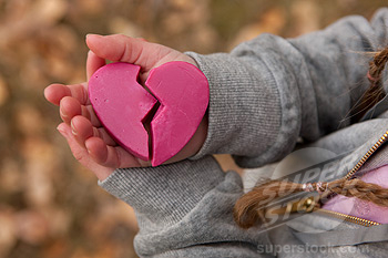 Girl holding broken heart